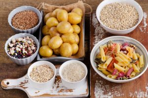 Healthy Food: Best Sources of Carbs on a wooden board. Top view